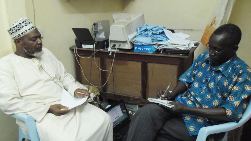UAMSHO ZANZIBAR spokesman, Sheikh Khamis Yusuf Khamis, Left, talks to Jaston Binala at UAMSHO ZANZIBAR offices