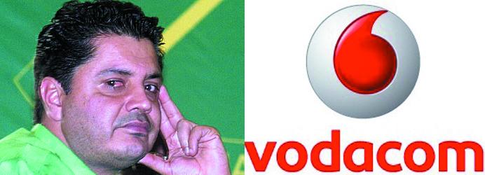 Rostam Aziz (Left), with Vodacom Tanzania Logo