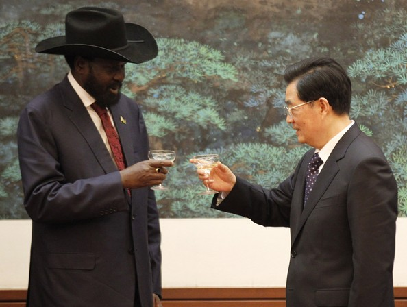 South Sudan president Salva Kiir (L) and Chinese president Hu Jintao toast each other during a signing ceremony at Great Hall of the People on April 24, 2012 on Beijing, China. President Kiir confirmed that he sees China as an important and strategic partner, while the meeting was held against a backdrop of recent violence between the the newly formed independent nation of South Sudan and Sudan, both countries from which China purchases oil.
