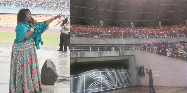 Tanzanian Gospel Music Singer Upendo Nkone (L) Sings at Na tional Stadium  at Easter festival in 2013 as packed Stadium listens