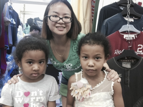 A trader with her Afro-Chinese daughters at the Tang Qi Arcade, in Guangyuan Xi Lu