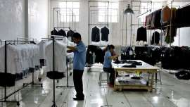 © Provided by Quartz Chinese textile industry workers check garments at a clothing factory in the outskirts of Beijing Monday May 30, 2005.