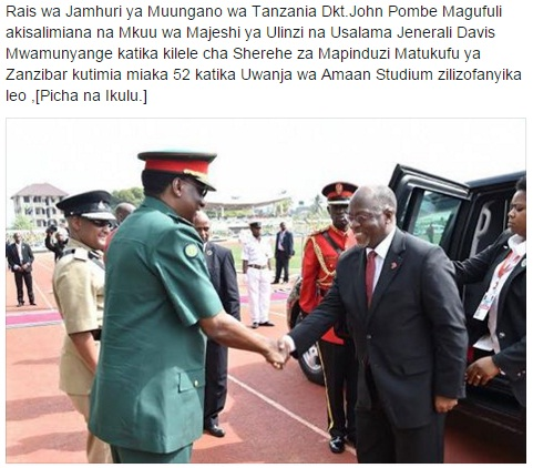 Chief of Tanzania Defence Forces Davis Mwamunyange welcomes Tanzania President John Pombe Magufuli at the ceremony in Zanzibar