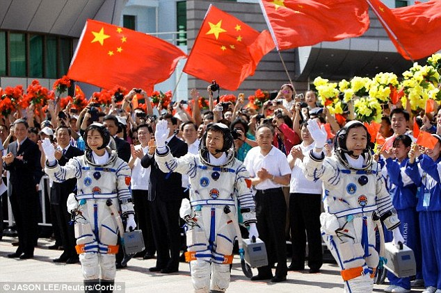 Chinese Taikonauts (astronauts) Jing Haipeng, Liu Wang and Liu Yang ahead of a space exploration launch in June 2012