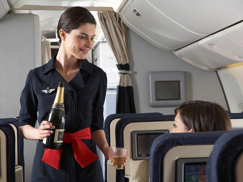 Air France Flight Attendant: No headscarfs here...