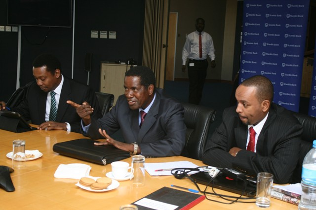 Stanbic Bank Tanzania Board Chairman Khatibu Senkoro (centre) speaks during a board meeting at the bank's Head Office in Dar es Salaam. He is flanked by Stanbic's Managing Director Bashir Awale (right) and the bank's Head of Legal Services Sioi Solomon (left). (Photo Credit: Issa Michuzi Blog).