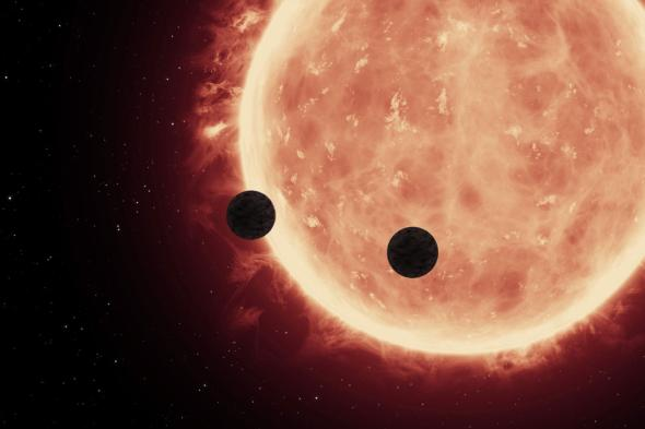This artist's view shows two planets passing in front of their host star TRAPPIST-1. ILLUSTRATION BY NASA, ESA, AND STSCI