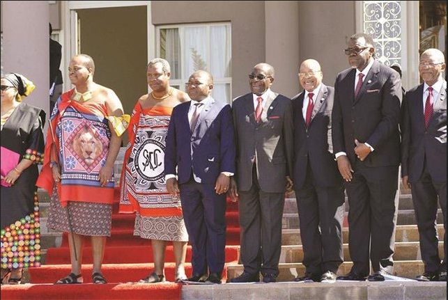 President Mugabe and his South African counterpart President Jacob Zuma share a j oke whi le posing for a group photograph with other regional leaders at the 36th Sadc Heads of State and Government Summit at Lozitha Palace, Swazi land, yesterday.(Photo Credit: Zimbabwe Presidential Photographer Joseph Nyadzayo)
