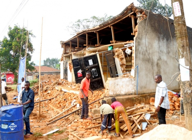 People remove wreckage of a house damaged following an earthquake measured 5.7 magnitude which struck Kagera region in north western Tanzania