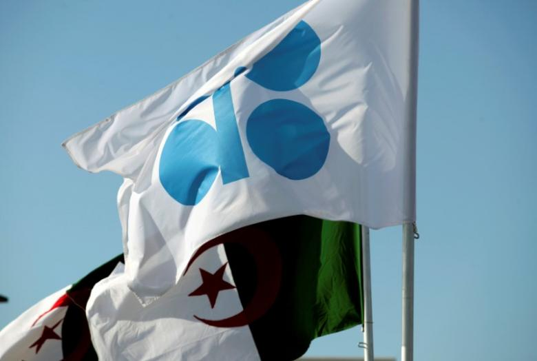 The OPEC and Algeria flags are pictured ahead of an informal meeting between members of the Organization of the Petroleum Exporting Countries (OPEC) in Algiers, Algeria September 28, 2016. REUTERS/Ramzi Boudina
