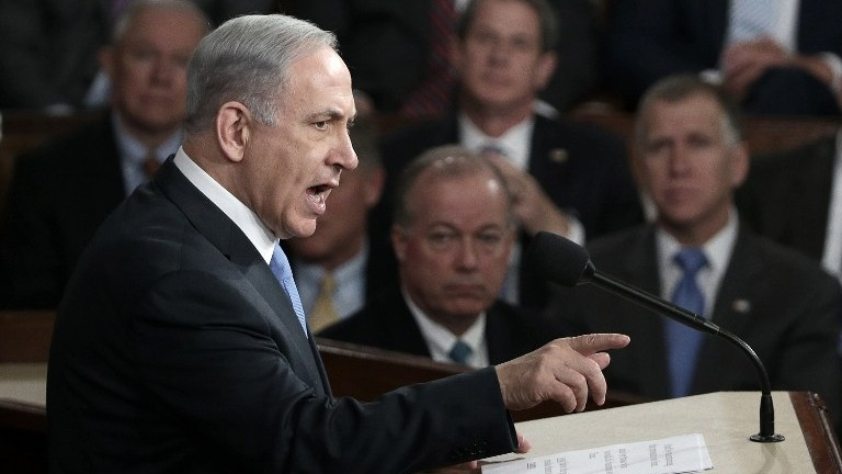 Prime Minister Benjamin Netanyahu addresses a joint meeting of the United States Congress in the House chamber at the US Capitol in Washington, DC on Tuesday, March 3, 2015, in a speech warning against the then-looming US-backed deal with Iran. (Win McNamee/Getty Images/AFP)